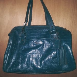 Coach satchel in a teal dark blue